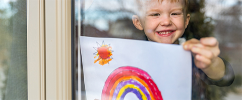 boy holding rainbow picture