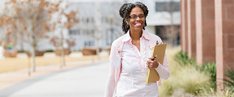 Woman outside with a clipboard