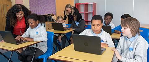 School children using donated laptops