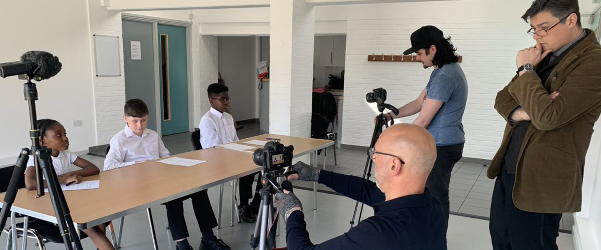 schoolchildren taking part in filming project