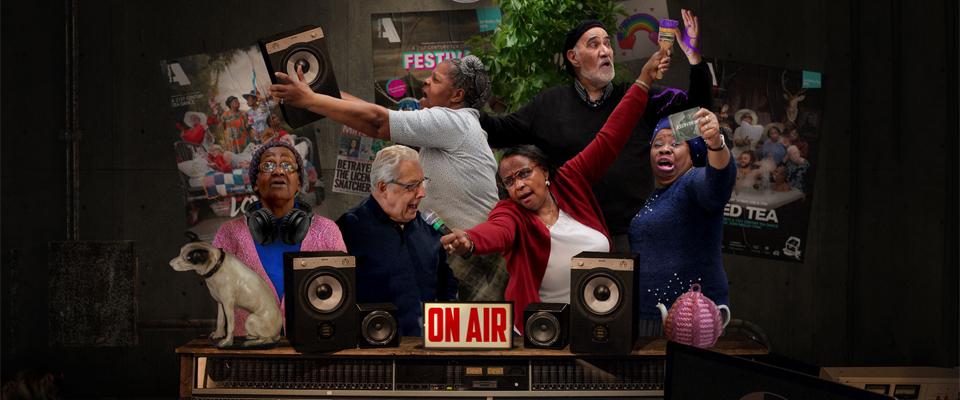 Older people posing in a studio booth