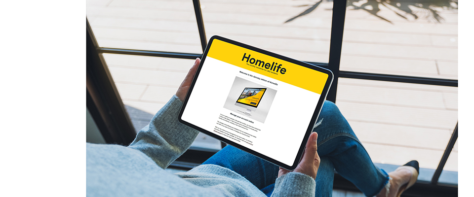 A person reading Homelife on a tablet device