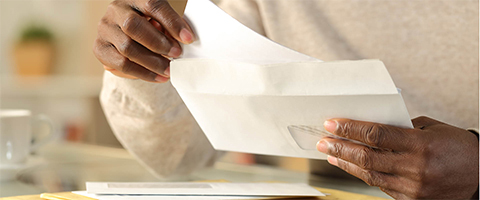 Man opening envelope